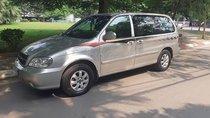 Cần bán lại xe Kia Carnival 2.5 AT đời 2009, màu bạc số tự động