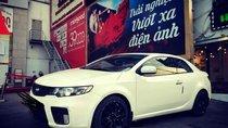 Cần bán gấp Kia Cerato 2009, màu trắng, số tự động