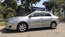 Cần bán xe Toyota Corolla altis G đời 2009, màu bạc, xe gia đình