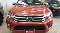 (Hãng) bán xe Toyota Hilux 2.8G 4x4 AT sản xuất 2016, màu cam, nhập khẩu