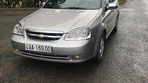 Bán Chevrolet Lacetti 1.6 đời 2012, màu bạc đã đi 40000 km