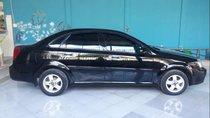 Cần bán lại xe Daewoo Lacetti năm sản xuất 2010, màu đen, nhập khẩu nguyên chiếc, xe gia đình