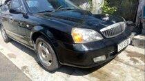 Cần bán xe Daewoo Magnus năm sản xuất 2004, màu đen, máy êm