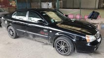 Cần bán gấp Daewoo Magnus 2.5L 2004, màu đen số tự động, giá tốt