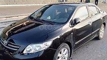 Cần bán xe Toyota Corolla Altis 1.8G MT 2009, màu đen chính chủ, giá 410tr