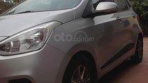 Bán xe Hyundai Grand i10 đời 2015, màu bạc, gia đình đi ít