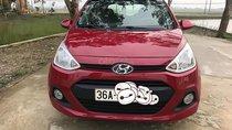 Cần bán gấp Hyundai Grand i10 1.0 MT Base năm 2014, màu đỏ, xe gia đình sử dụng