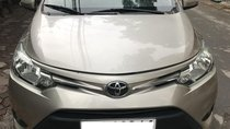 Cần bán Toyota Vios E sản xuất năm 2015, màu ghi vàng