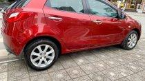 Cần bán Mazda 2 AT 2013, màu đỏ