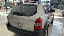 Cần bán Hyundai Tucson sản xuất 2009, màu bạc, nhập khẩu nguyên chiếc
