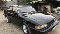 Cần bán gấp Mazda 626 đời 1986, màu đen, xe nhập còn mới