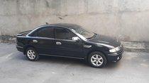 Bán xe Mazda 323 1.6 MT năm sản xuất 2000, màu đen