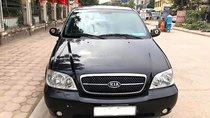 Cần bán xe Kia Carnival GS 2.5 AT sản xuất năm 2009, màu đen chính chủ