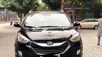 Cần bán xe Hyundai Tucson 2.0 AT CRDi năm 2009, màu đen, nhập khẩu