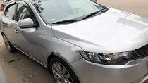 Cần bán Kia Forte đời 2010, màu bạc, xe như mới