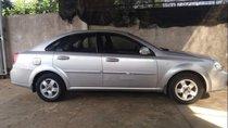 Cần bán lại xe Daewoo Lacetti đời 2010, màu bạc xe gia đình