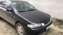 Bán Mazda 323 năm 2001, màu đen, xe nhập