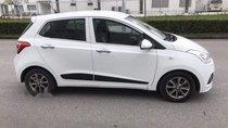 Bán xe Hyundai Grand i10 năm sản xuất 2014, màu trắng, nhập khẩu