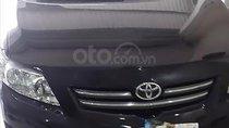 Cần bán xe Toyota Corolla altis 1.8G MT đời 2009, màu đen chính chủ, 395 triệu