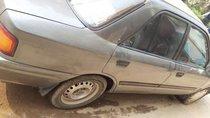 Cần bán lại xe Mazda 323 năm 1996, màu bạc giá cạnh tranh