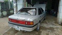 Cần bán Mazda 323 sản xuất 1996, màu bạc, xe nhập giá cạnh tranh