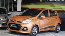 Bán ô tô Hyundai Grand i10 1.2AT 2014, màu cam, xe nhập