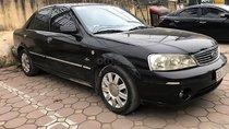 Bán xe Ford Laser sản xuất năm 2004, số tự động, máy xăng, màu đen, nội thất màu ghi