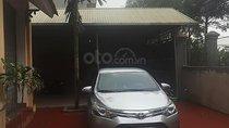 Bán Toyota Vios sản xuất 2014, màu bạc xe gia đình
