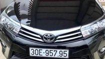 Cần bán Toyota Corolla Altis 1.8MT sản xuất 2017, màu đen, xe vẫn còn bảo hiểm thân vỏ