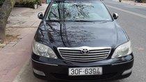 Cần bán Toyota Camry 3.0V đời 2003, màu đen, 310 triệu