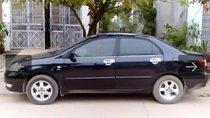 Cần bán lại xe Toyota Corolla Altis sản xuất 2004, màu đen, giá tốt