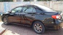 Bán ô tô Toyota Corolla altis 1.8G AT đời 2014, màu đen, 590tr