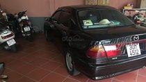 Bán Mazda 323 đời 2000, màu đen, thay dầu máy định kỳ, tiết kiệm nhiên liệu, 7 lít/100km