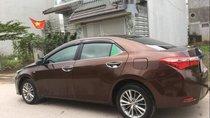 Bán Toyota Corolla altis đời 2015, màu nâu chính chủ, 660 triệu