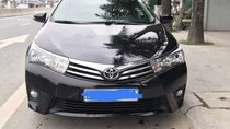 Bán Toyota Corolla altis đời 2015, màu đen số sàn