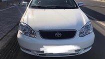 Bán Toyota Corolla Altis sản xuất 2003, màu trắng, nhập khẩu, xe không bị cấn móp, va chạm hay taxi