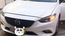 Nhà đi cần bán Mazda 6 bản 2.0 AT đời 2015, đi được 12 vạn, màu trắng Ngọc Trinh, xe nhà giữ gìn, bao test thoải mái