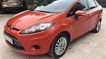 Chính chủ cần bán xe Ford Fiesta 2012, màu đỏ đồng (cam), đăng ký lần đầu tháng 9/2012