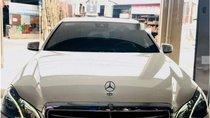 Bán Mercedes E200 đời 2014, màu trắng, đã đi 50.000km