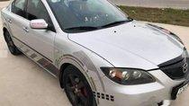 Bán Mazda 3 sản xuất năm 2004, màu bạc, số tự động