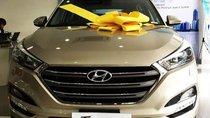 Bán Hyundai Tucson 1.6 Turbo sản xuất năm 2019, màu vàng, giá 890tr