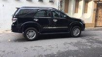 Cần bán Toyota Fortuner 2.7V 4x2 AT đời 2014, màu đen