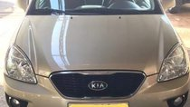 Cần bán Kia Carens MT 2014, màu vàng, xe gia đình