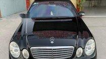 Bán xe Mercedes E200 đời 2005, màu đen, xe nhập