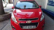 Bán Chevrolet Spark AT đời 2014, màu đỏ, xe đi hơn 28.000km