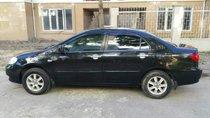 Bán xe Toyota Corolla Altis, màu đen, đời 2004, số tay, nhiên liệu 7 lít, mới đi 12,0000 km
