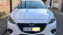 Cần bán xe Mazda 3 sản xuất 2015, màu trắng chính chủ, 570 triệu
