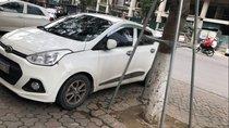 Cần bán gấp Hyundai Grand i10 AT 1.0 2014, màu trắng, xe đẹp