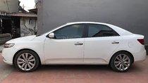 Cần bán Kia Cerato 1.6 AT năm sản xuất 2010, màu trắng, nhập khẩu nguyên chiếc