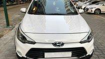Bán xe Hyundai i20 Active 1.4 AT sản xuất 2015, màu trắng, nhập khẩu